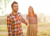 Couple Holding Hands Walking Away, smiling — Stock Photo