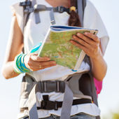 Beautiful tourist woman on vacation with a city map — Stock Photo