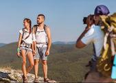 Photographer taking photos in the mountains — Stock Photo