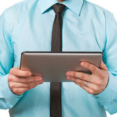 Businessman using a tablet computer - isolated over a white back — ストック写真