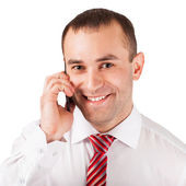 Closeup of happy young man using mobile phone — Stock Photo