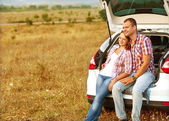 Couple in the mountains by car — Stock Photo