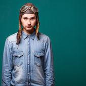 Fashion male pilot in the studio — Stok fotoğraf