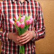 Loving couple - man with rose waiting his woman. Valentine's Day — Stock Photo #39669341