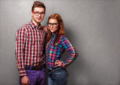 Couple of guys dressed in clothes hipsters are in the studio — Stock Photo