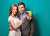 Beautiful couple in love with flowers tulips.Valentine's Day — Stockfoto