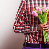 Loving couple - man with rose waiting his woman. Valentine's Day — Stock Photo