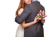 Young couple in love holding a bouquet of tulips. The concept of — Stock Photo