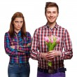 Young couple in love holding bouquet of tulips. — Stock Photo #40383739
