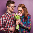 Portrait of young couple in love with flowers tulips — Stock Photo #40384919