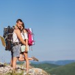 Hikers - people hiking, man looking at mountain nature landscape — Stock Photo #40385221