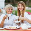 Adult mother and daughter drinking tea or coffee. — Stock Photo #40385455
