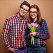 Stock Photo: Young couple in love holding bouquet of tulips.