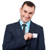 Part of body of business man who takes out business card from the pocket — Stock Photo