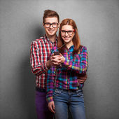 Young couple listening music together. Hipster style. — Stock Photo