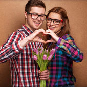 Beautiful couple in love with flowers tulips.Valentine's Day — Stock Photo
