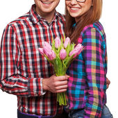 Couple in love with a bouquet of tulips are close to each other  — Stock Photo
