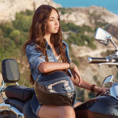 Biker girl sits on a motorcycle — Stock Photo