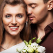 Couple in love with a bouquet of flowers are close to each other — Stock Photo
