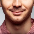 Charming and handsome man half face close up — Stock Photo