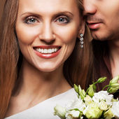 Couple in love with a bouquet of flowers are close to each other — Foto de Stock