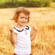 Little girl running on meadow with sunset — Stock Photo #42823891