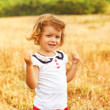Little girl running on meadow with sunset — Stock Photo #42823933