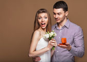 Couple in love  with wedding ring and gift box — Stock Photo