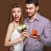 Couple in love  with wedding ring and gift box — Foto de Stock