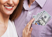 Fashion beautiful couple in love holding money the family budget — Zdjęcie stockowe