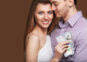 Fashion beautiful couple in love holding money the family budget — Foto Stock