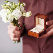 Happy man holding an engagement ring box — Stock Photo