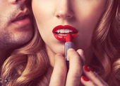 Beautiful portrait of young man lips — Stock Photo