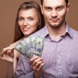 Loving couple are holding a large sum of money. Business concept — Stock Photo