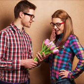 Man giving bouquet girl. Valentine's Day — Stock Photo