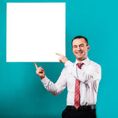 Close up of man hands showing white blank board — Foto Stock
