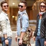 Three Young male fashion metraseksuals shop. Men shopping walk. — Stock Photo #46309999