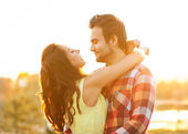 Young couple in love walking in the park near the river. — Stock Photo