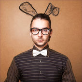 Fashion guy in bunny ears — Stock Photo