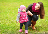 Mother and baby in park portrait — Stock Photo