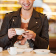 Two young hipster guy sitting in a cafe chatting and drinking — Stock Photo