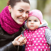Mother and baby in spring park portrait — Stock Photo