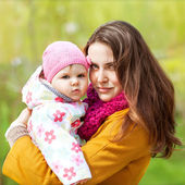 Young mother and her toddler girl have fun  — Stock Photo