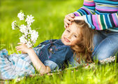 Happy mother and daughter laughing together outdoors — Stock Photo