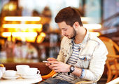 Young fashion man with beard drinking espresso coffee — Stock Photo