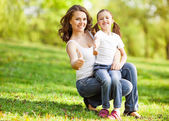 Mother and daughter in park. Mothers Day. — Stock Photo