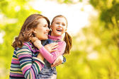 Mother and daughter in park happy. Mother Day. — Stock Photo