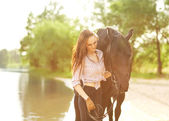 Young woman with a horse  — ストック写真
