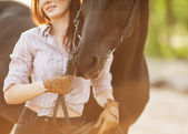 Beautiful woman and horse. Backlight. — Stock Photo