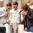 Three Young male fashion metraseksuals shop shopping walk — Stock Photo